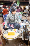 Asian woman selling tofu at marketplace. Bagan, Myanmar Stock Image