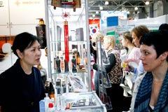 Asian woman sells cosmetics Royalty Free Stock Photography