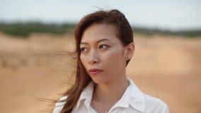 Asian woman serious sad looking outdoor desert stock footage