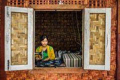 Asian woman sewing in Yangon, Myanmar Stock Photos