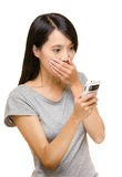 Asian woman shocking about the things on mobile Royalty Free Stock Photos