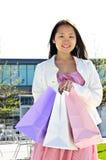 Asian woman shopping Stock Photo