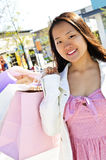 Asian woman shopping Royalty Free Stock Photos
