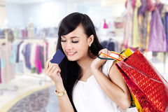 Asian woman with shopping bag and a credit card Royalty Free Stock Image