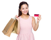 Asian woman with shopping bag and credit card. Isolated on white Stock Image