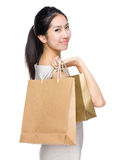 Asian woman with shopping bag Stock Photography