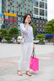 Asian woman shopping bag talking cell phone call Stock Photography