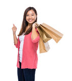 Asian woman with shopping bag and thumb up Stock Photography