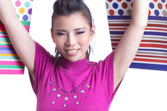 Asian woman and shopping bag Royalty Free Stock Photos