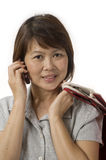 Asian woman with shopping bags Stock Photography