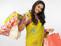 Asian woman with shopping bags Stock Photos