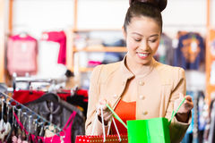 Asian Woman with shopping bags stock images