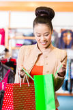 Asian Woman with shopping bags Royalty Free Stock Images