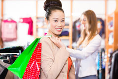 Asian Woman with shopping bags Royalty Free Stock Photography