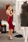 Asian woman shopping choosing trying dress Stock Photo
