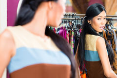 Asian woman shopping in fashion store Stock Photography