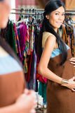 Asian woman shopping in fashion store Royalty Free Stock Photo