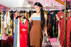 Asian woman shopping in fashion store Royalty Free Stock Photos
