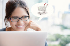 Asian woman shopping online Stock Images