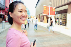 Asian woman at shopping street Stock Photography
