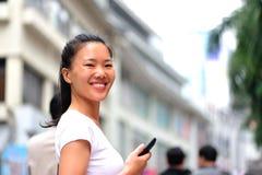 Asian woman use smart phone at shopping street Royalty Free Stock Image