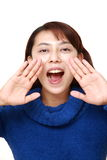 Asian woman shout something. Studio shot of young asian woman on white background Royalty Free Stock Images
