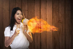 Asian Woman Shouting Megaphone On Fire Royalty Free Stock Images