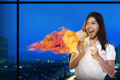 Asian Woman Shouting Megaphone On Fire Stock Photos