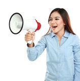 Asian woman shouting with a megaphone. Young attractive asian woman shouting with a megaphone Royalty Free Stock Images
