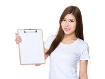Asian woman show with blank page on clipboard. Isolated on white background Royalty Free Stock Photography