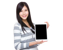 Asian Woman show with blank sceen of tablet Royalty Free Stock Photo