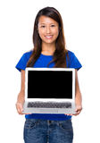 Asian woman show with blank screen of laptop computer Stock Photo