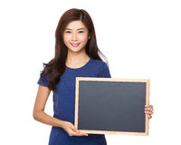 Asian woman show the blank sign of blackboard Royalty Free Stock Images