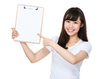 Asian woman show with clipboard. Isolated on white background Stock Image
