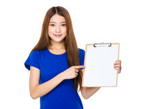 Asian woman show with clipboard. Isolated on white background Royalty Free Stock Photography