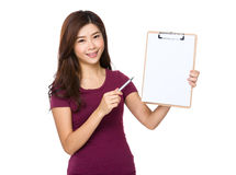 Asian woman show with clipboard. Isolated on white background Royalty Free Stock Photos