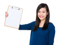 Asian woman show with the clipboard. Isolated on white background Royalty Free Stock Photo