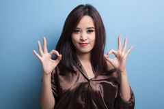 Asian woman show double OK hand sign  and smile. Stock Photography
