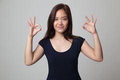 Asian woman show double OK hand sign  and smile. Stock Images