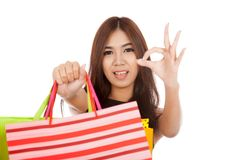 Asian woman show shopping bags and  OK sign Royalty Free Stock Photos