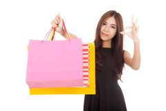 Asian woman show shopping bags and  OK sign Royalty Free Stock Photography