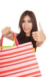Asian woman show shopping bags and  thumbs up Royalty Free Stock Photography