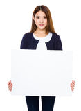 Asian woman showing banner Stock Photo