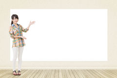 Asian woman showing blank banner Stock Images