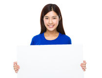 Asian woman showing a blank sign of the placard Royalty Free Stock Photos
