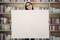 Asian woman showing empty banner Royalty Free Stock Images