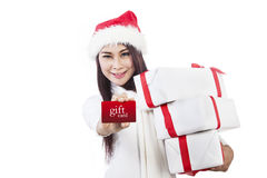 Asian woman showing gift card and christmas boxes Stock Image