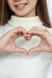 Asian woman showing heart sign . Stock Photography