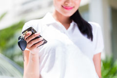 Asian woman showing key of new car Royalty Free Stock Photography