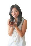 An Asian woman showing red grape Royalty Free Stock Photos